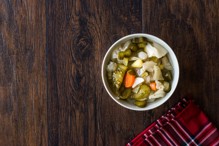 Mix of Turkish Pickles with Hot Green Pepper, Cabbage, Sauerkraut, Carrot and Cucumber in Bowl.