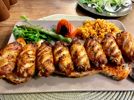 Turkish Style Spicy Chicken Wings Kebab  Kebap served at Restaurant. Traditional Recipe Food. Stok Fotoğraf