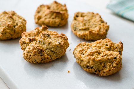 Homemade Salty Yogurt Cookies with Rolled Oats / Salted Pastries on Marble Surface. Organic Food.