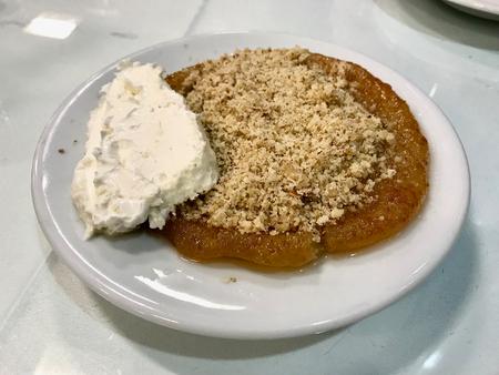 Turkish Dessert Yassi Kadayif with Butter Cream and Powdered Walnut Powder. Traditional Food.