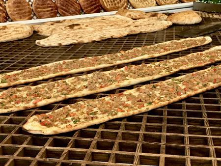 Turkish and Arabic Traditional Ramadan Bread Sliced Etli Ekmek Kebab with Minced Meat (Pide or Lahmacun Kebap) serving on wood by Konya or Sivas Imagens