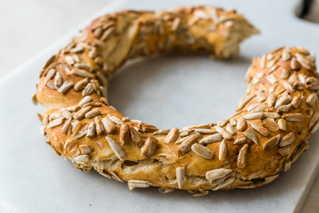 Turkish Bagel Simit with Sunflower / Kernel Seeds on Marble Board. Organic Food. 스톡 콘텐츠