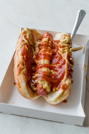 Box of Hot Dog with Ketchup and Mustard / Sausage Sandwich. Fast Food.