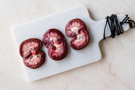Sliced Raw Lamb Kidney on Marble Board. Organic Product. Фото со стока