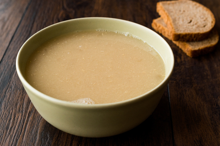 Wheat Soup with Chicken Broth Bouillon on Dark Wooden Surface. Organic Food. Фото со стока