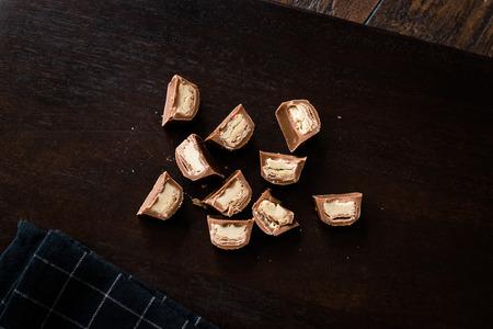 Tahini Filled Chocolate Pieces on Dark Wooden Surface  Tahin. Organic Snacks.