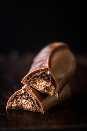 Tiramisu Flavored Chocolate Bar on Dark Wooden Surface. Dessert Snacks.