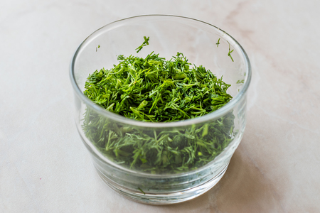 Chopped Dill in Glass Bowl for Salad. Organic Food.