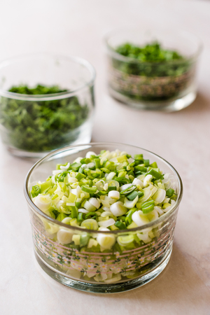 Chopped Chives, Parsley and Dill in Glass Bowls. Organic Food. Stock Photo