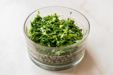 Chopped Parsley in Glass Bowl for Salad. Organic Food.