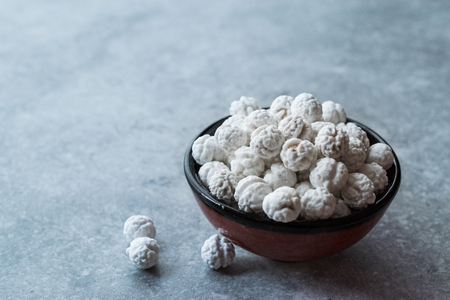 White Roasted Chickpeas with Sugar in Small Bowl. Snacks.