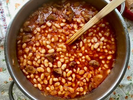Turkish Kuru Fasulye  Baked Beans in Pot. Traditional Organic Food.