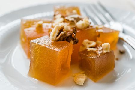 Turkish Crispy Pumpkin Dessert from Hatay  Kirecte Kabak Tatlisi with Walnut Powder. Traditional Organic Dessert.