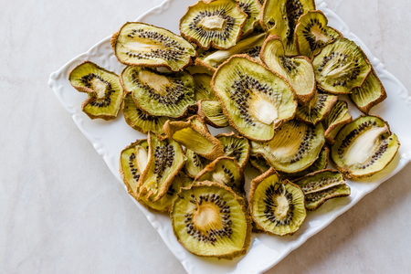Dried Kiwi Slices with Plate  Organic Dry Fruit. Fresh Organic Food.