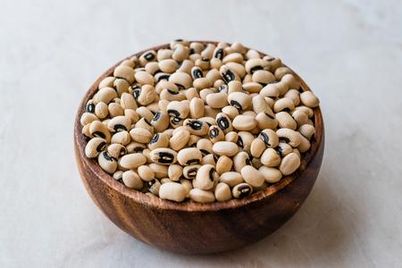 Raw Organic Fresh Black Eye Peas in Wooden Bowl. Organic Food.