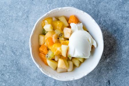 Fruit Salad with Vanilla Ice Cream in Ceramic Bowl Ready to Eat. Reklamní fotografie