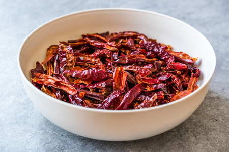 Stack of Dried Red Chili or Chilli Cayenne Pepper in Bowl. Organic Food.