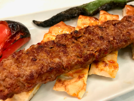 Turkish Adana Kebab with Minced Meat (Urfa Kebap). Traditional Meat Food.