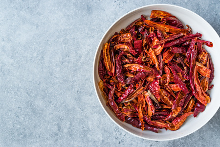 Stack of Dried Red Chili or Chilli Cayenne Pepper in Bowl. Organic Food. Stock fotó