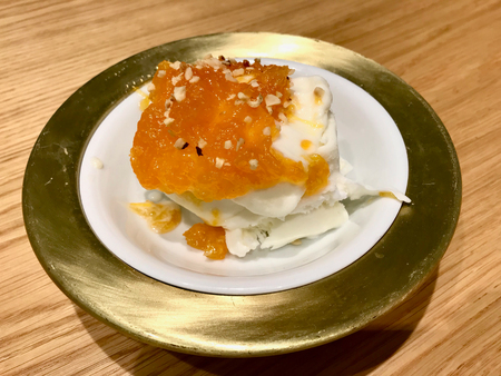Vanilla Ice Cream with Pumpkin Sauce and Walnut served with Bowl. Organic Food.