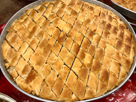 Traditional Turkish Dessert Homemade Baklava in Tray for Sale. Organic Food.