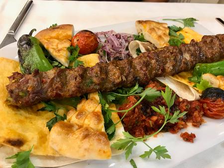 Turkish Adana Kebab / Kebap with Flatbread at Oriental Restaurant. Traditional Food.