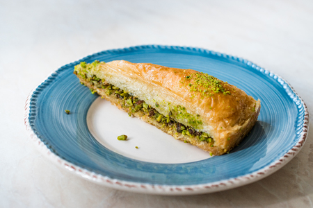Turkish Baklava with Pistachio served with Plate  Havuc Dilimi. Traditional Dessert.