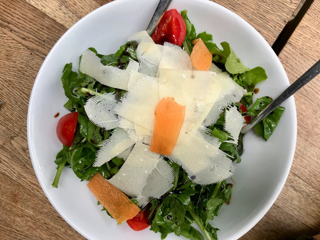 Parmesan Salad with Arugula, Rucola or Rocket Leaves and Cherry Tomatoes. Organic Food.