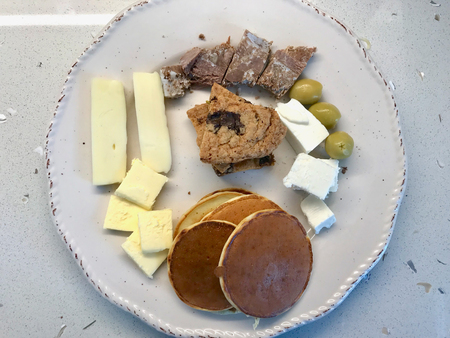 Pancake Breakfast with Kavurma Meat, Cookies and Cheese Slices on Wooden Table. Organic Breakfast.
