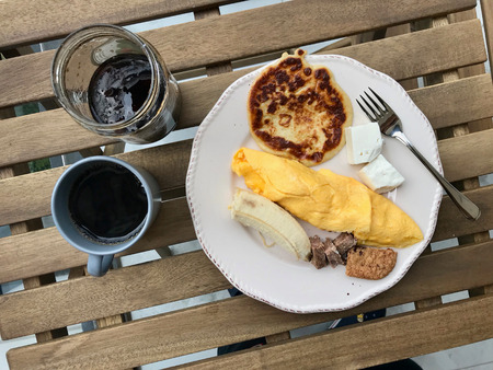 Pancake Breakfast with French Omelette, Banana, Meat, Cookie, Cheese and Coffee at on Wooden Table. Homemade Food. Reklamní fotografie - 123096304