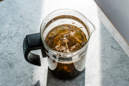 Green Tea with French Press in Daylight. Organic Hot Beverage. Reklamní fotografie