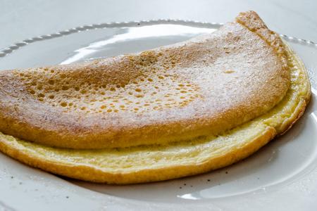 Fluffy Omelette Homemade Mont Saint Michel Style for Breakfast. Organic Food.