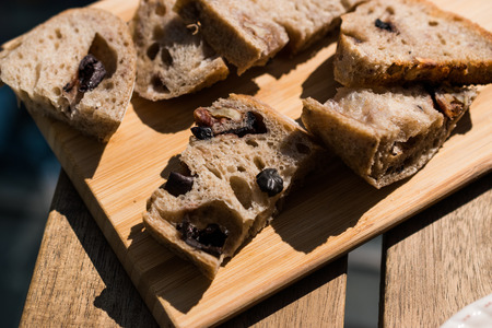 Artisan Bakery Bread Slices with Walnut and Dried Grape. Organic Food.