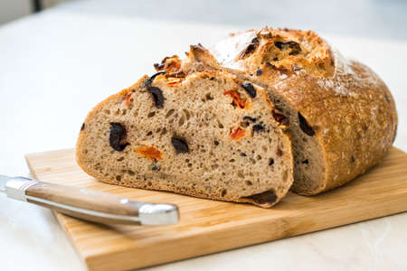 Artisan Bakery Bread with Dried Tomatoes and Black Olive Ready to Eat. Organic Food.
