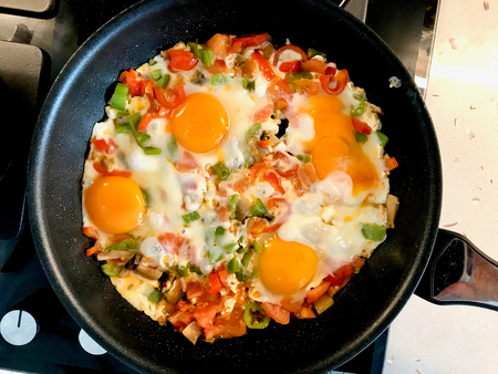 Fried Eggs with Vegetables in Pan Cooking for Breakfast.