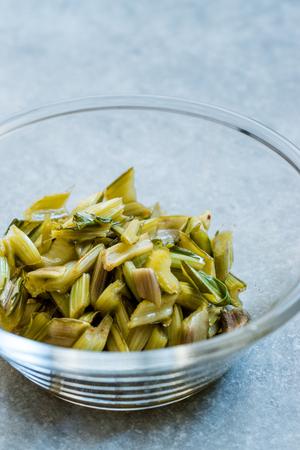 Marinated Chard Root Pickles Cut Diagonal  in Glass Bowl. Organic Food.