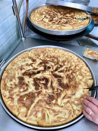 Su Boregi  Whole Turkish Borek  Burek on Tray. Traditional Food.