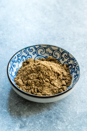Indian Garam Masala Powder in Small Traditional Porcelain Bowl. Organic Spice.