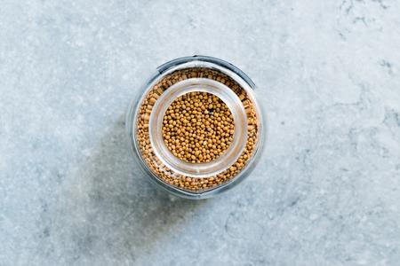 Organic Yellow Mustard Seeds in Glass Jar. Organic Product. Reklamní fotografie