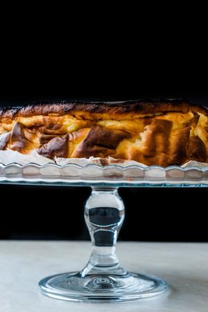 San Sebastian Cheesecake on Glass Cake Plate.  Creamy Plain. Traditional Spain Style.