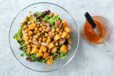 Chickpea Salad with Sweet Potatoes and Spicy Red Sauce. Organic Food.