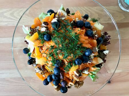 Raw Fruit Salad with Blueberries, Dried Apricot, Radish, Dill, Walnut and Orange Juice Sauce. Organic Food.