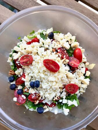 Authentic Turkish Goat's Milk Tulum Cheese Salad with Cherry Tomatoes, Blueberry and Walnut. Organic Food. Stock Photo