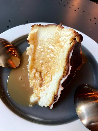 Dulce De Leche Sauce Cheesecake Slice served with two Spoon / Milk Jam for Organic Dessert.