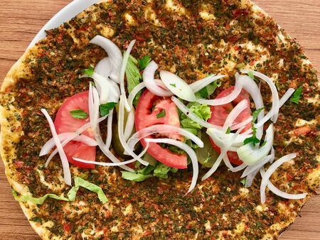 Lahmacun Turkish Traditional Pizza with Minced or Lamb Meat, Onions and Tomatoes. Fast Food.