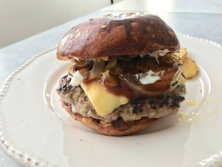 Homemade Hamburgers with Cheddar Cheese and Caramelized Onions. Fast Food. Stock Photo