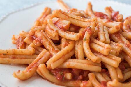 Sicilian Pasta Fusillata Casareccia with Tomato Sauce. Organic Traditional Food.