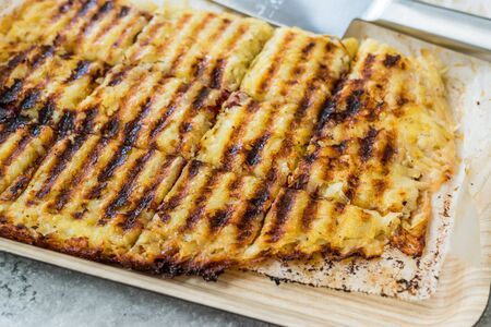Turkish Toast with Potatoes and Melted Cheese and Sucuk. Traditional Fast Food.