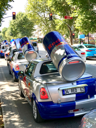 Istanbul, Turkey - June 23, 2019: Red Bull mini cooper publicity car with a can of red bull drink behind at the Red Bull Speed Street. Editorial Image.