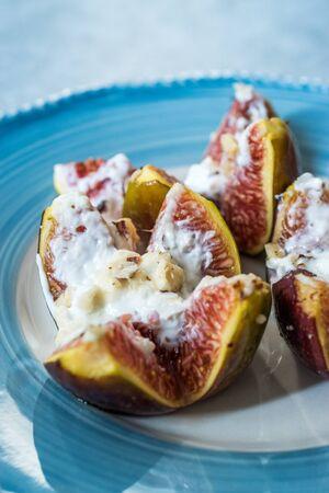 Figs with Goat Cream Cheese, Honey and Hazelnut Powder. Organic Snacks.